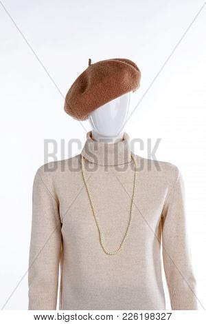 Brown Beret And Beige Sweater. Female Mannequin With Turtleneck Pullover And Headgear. Ladies Pearl