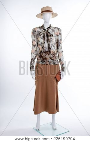 Hat, Blouse, Skirt And Wallet. Female Mannequin Dressed In Straw Hat, Chiffon Blouse And Skirt. Femi