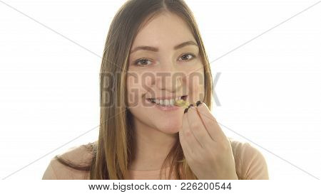 Young Woman Eating Fried Potatoes, Harmful Food