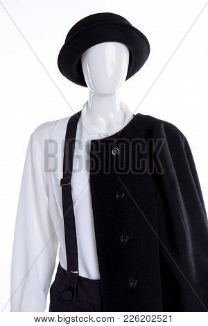 White Blouse, Black Hat And Coat. Female Mannequin With White Shirt, Black Suspenders, Hat And Overc