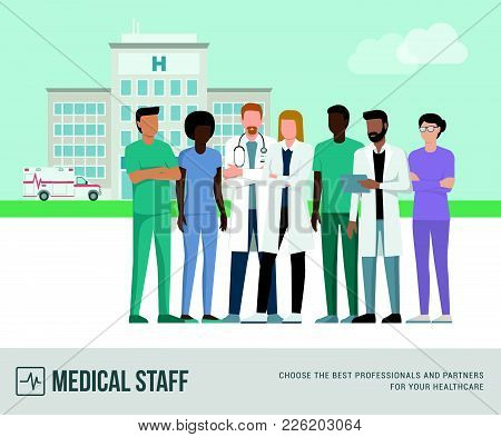 Medical Staff Standing Together: Doctors, Nurses And Surgeons, Hospital Building And Ambulance On Th