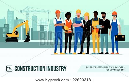 Construction Workers And Engineers Posing Together At The Construction Site, Machinery And Crane On