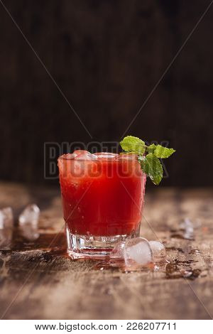 Refreshing Summer Watermelon Juice In Glasses On Wooden Table.