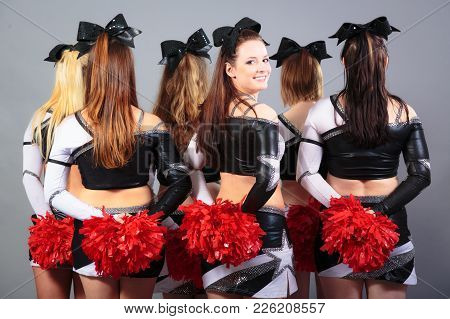 Studio Shot Of Group Of Cheerleaders, Back View