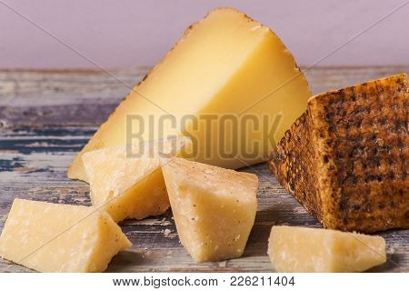 Organic Appetizer Cheese On Rustic Black Board;