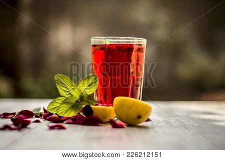 Popular Indian/asian Sharbat I.e Gulab Ka Sharbat With Sliced Lemon,citrus × Limon,rosa,rose Petals