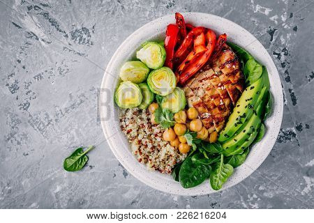 Vegetable Bowl Lunch With Grilled Chicken And Quinoa, Spinach, Avocado, Brussels Sprouts, Paprika An