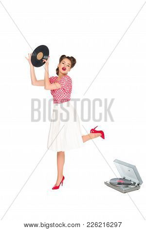 Emotional Woman In Pin Up Style Clothing With Vinyl Record In Hands Standing Near Phonograph Isolate