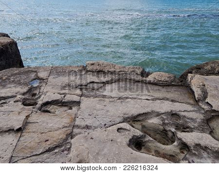 Rocky Shore Of The Caspian Sea. The Texture Of The Stone.