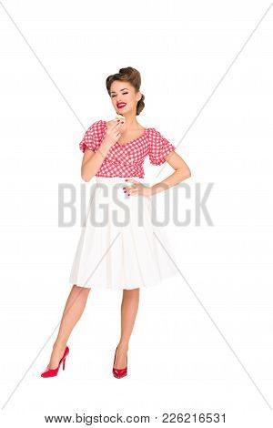 Beautiful Smiling Woman In Pin Up Clothing With Cupcake Isolated On White