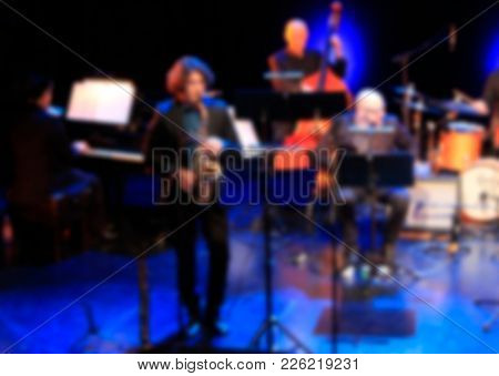 jazz concert background, defocused blurry with unrecognizable players