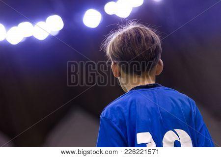 Young Boy In A Sport Jersey. Kid In Blue Sporty Shirt. Football Child Portrait. Sport Stadium Lights