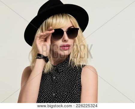 Portrait Blonde Girl In Elegant Dress And Trendy Black Hat, Sunglasses. Fashion Young Woman In Styli