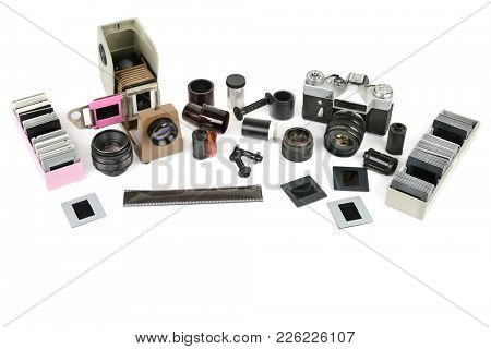 Accessories old film camera and slide projector isolated on white background