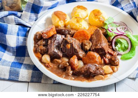 Beef Bourguignon Stew Served With Baked Potatoes