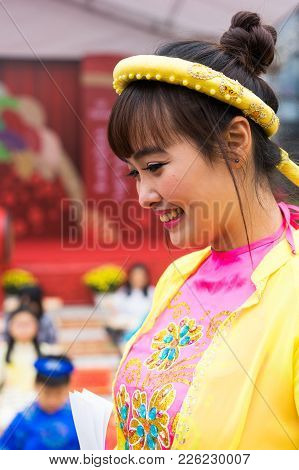 Hanoi, Vietnam - Feb 7, 2015: Vietnamese Woman In Traditional Dress Pajamas, A Kind Of Shirt Used By