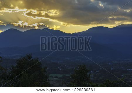 Beautiful Scenery Of Mountains And Sunrays In Countryside In Twilight In The Morning , Thailand
