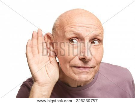 Elderly man with hearing problem on white background