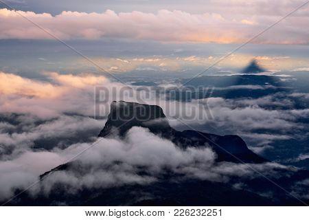 Mountain Peaks Near Mount Adam Peak In The Clouds. Panoramic Landscape