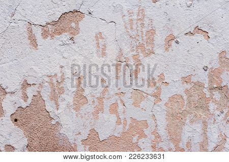 Textured Background White Cracked Plaster Partially Sprinkled With A Pink Shaded Cracked Wall. Grung