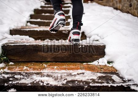 Feet Of Unrecognizable Cross-country Skier, Walking Up The Stairs. Winter Time.