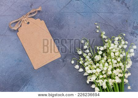 Lilly Of The Valley White Flowers On For Mothers Day On Gray Stone Background With Copy Space On Pap