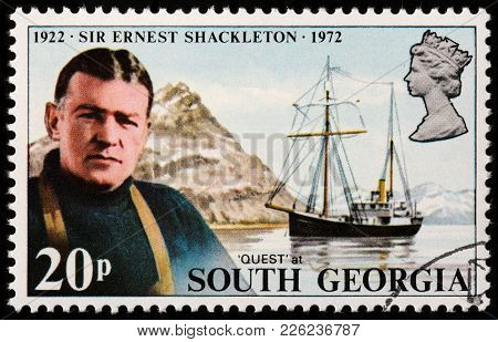 Luga, Russia - February 08, 2018: A Stamp Printed By South Georgia Shows Image Portrait Of Sir Ernes