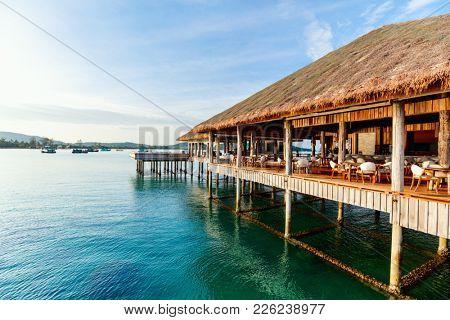 Tropical overwater bar in a luxury resort