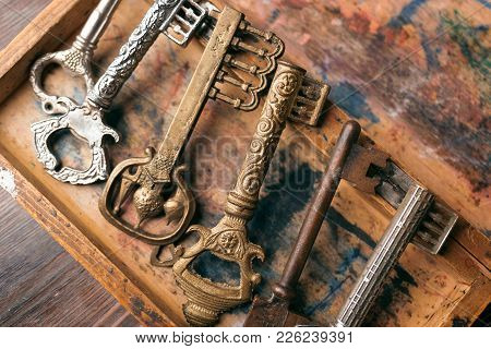 Old Carved Keys On A Vintage Board With A Shabby Paint