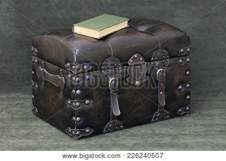 Chest With The Lid Closed And The Book On Top