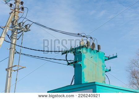 Electric Substation On A Background Of Blue Sky.