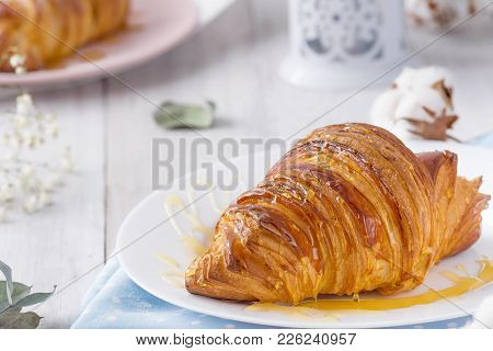 Delicious Continental Breakfast With Fresh Flaky French Croissants Whith Honey, Close Up On The Croi