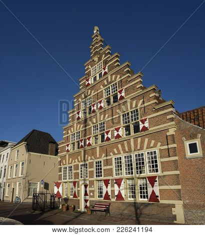 A Traditional Old Vintage Dutch House With Stepped Rooftops And Old Vintage Window Shutters In Leide