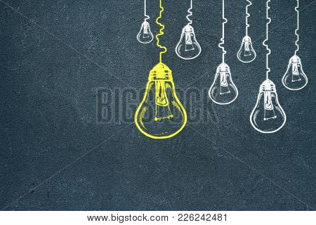 Creative Lamp Sketch On Concrete Wall Background. Idea, Innovation And Leadership Concept