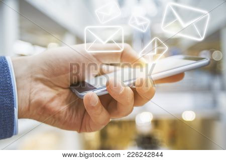 Side View Of Businessman Hand Using Smartphone With Creative E-mail Network. Email Communication Con