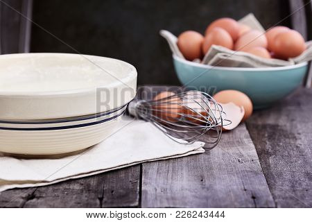 Bowl Of Homemade Pancake Batter Mix With Farm Fresh Brown Eggs In Background. Extreme Shallow Depth
