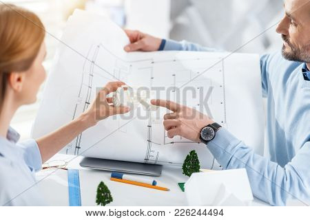 Team Work. Handsome Serious Bearded Man Holding A Drawing And Working With His Colleague Holding A M