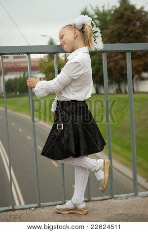 Schoolgirl standing near handhold