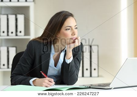 Distracted And Bored Businesswoman Ready To Sign A Contract Thinking Looking Away At Office