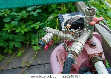 Electric Water Pump With Fittings. Water System Valves, Pump Motor