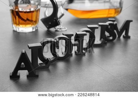 Composition with alcohol, handcuffs and word