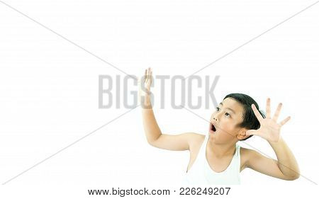 A Boy Shocked With Big Eyes Opened And Hands Up On White Background.