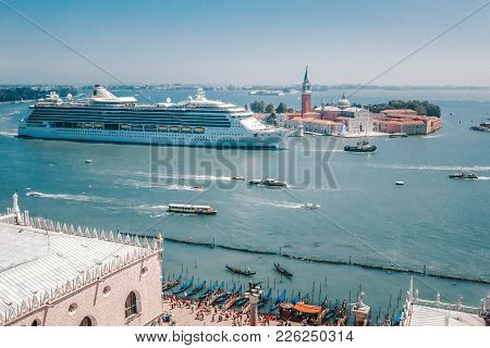 A Large Cruise Liner Enters Port Venice On The Grand Canal Past The Dodge Palace And Cathedral Of Sa