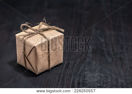Single Paper Box On Black Wooden Background, Close Up, Concept Of Sale In China Single Day