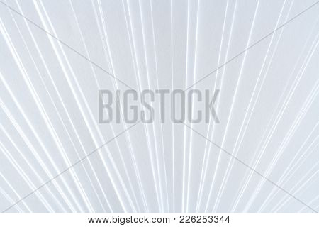 White Symmetric Geometric Pattern Of Clean Paper Sheets, Spaced As Fan.
