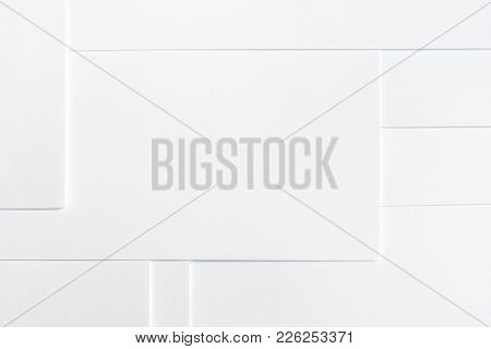 Abstract White Minimalist Background Of Clean Paper Sheets Neatly Laid Out In Geometric Pattern.