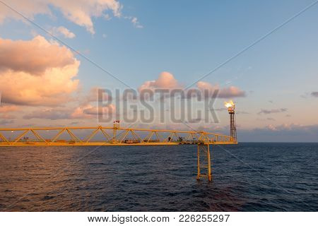 Flare Stack And Flare Bridge While Burning Toxic Gas And Release Over Pressure Of Production Process