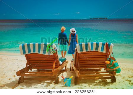 Happy Couple Relax On A Tropical Beach Vacation