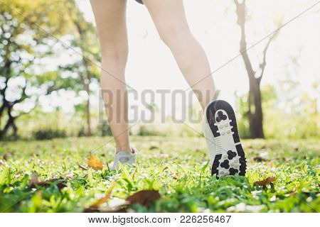 Close Up Of A Young Woman's Legs In Warming Up The Body By Stretching Her Legs Before Morning Excerc
