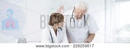 Doctors Talking In Medical Centre